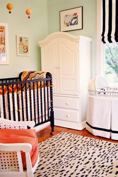 retro. glam. black and white accents. hot air balloon mobile. i love everything about this entire nursery: http://candyshopvintage.blogspot.com/2012/04/back-to-work.html