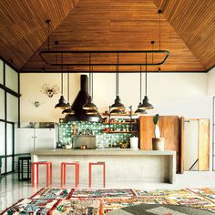 Rodman Primack and Rudy Weissenberg's home in Guatemala City mixes work by local artisans and established contemporary artists, such as stools by Assume Vivid Astro Focus and tiles by Dario Escobar. The colorful carpet is a patchwork of small rugs found at a local tourist market. (Photo: Ben Hoffmann)
