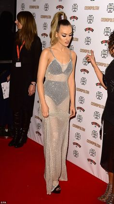 Easy does it: Perrie played with the hem of her dress, careful not to trip on it wearing her chunky heels