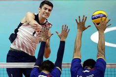 US men's volleyball team beats France, stays in medal chase:  August 13, 2016  -    United States' Matthew Anderson, left, spikes the ball as France's Kevin Tillie center, and Nicolas le Goff block during a men's preliminary volleyball match at the 2016 Summer Olympics in Rio de Janeiro, Brazil, Saturday, Aug. 13, 2016. (AP Photo/Matt Rourke)