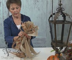 DIY Fall Lantern Swag with RAZ sprays, cotton boll, mixed berry, autumn elf