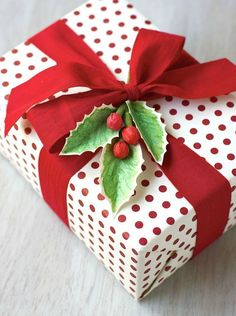 Nothing says Christmas like a bough of holly. Take your gift wrapping to the next level by attaching a DIY sprig.  Get the tutorial at Urban Comfort.  - http://WomansDay.com