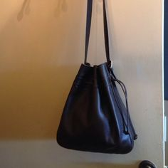 Auth  leather longchamp drawstring purse Auth Brown leather long champ purse fully linned needs polish adjustable strap modern design Longchamp Bags Shoulder Bags