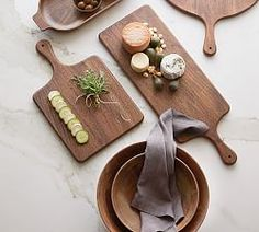 We've given antique European wood tableware designs an updated silhouette and artisan finish to create our Chateau Collection. Crafted of solid acacia, these bowls reveal the beauty of the wood's grain and are designed as serving piece… Wood Pizza, Serveware, Tableware, Kitchenware, Cheese Knife Set, Cheese Dome, Wine Cheese, Wood Cutting Boards, Wood Slab