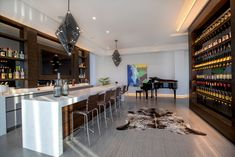 cabinets for home bar: Smoked French Oak Veneered panels were used for Bar back wall & wine cellar cladding. Custom hi-end cabinets made in Germany Modern Home Bar, Veneer Panels, Gym Room, Layout, French Oak, Beautiful Kitchens, Bars For Home, Cladding, Home Values