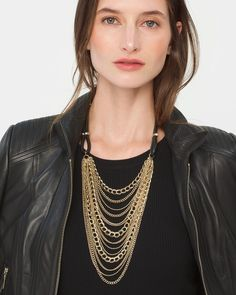 """Add this pièce de résistance to your jewelry mix to create instant drama. The statement necklace touts layer upon layer of chains with black leather. They're chains we love especially with a sleek crewneck, leather moto and ponte pants. Layered chain necklace with black leather  Approx. 20"""" in length with 2"""" extender Goldtone; lobster close; glass stones Custom designed exclusively for WHBM. Handcrafted with nickel-free and lead-free metal."""