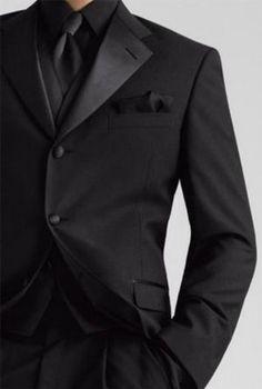 All black tuxedo with a calla lily for colour