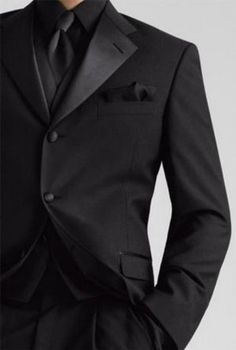 All black tuxedo with a calla lily for colour