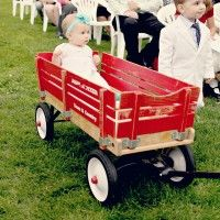 When your flower girl is too young to walk all the way down the aisle =) www.happilywedding.com