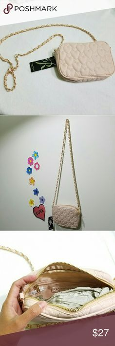 Rampage Small Crossbody Bag Can be worn as a shoulder or crossbody bag. Strap is about 50in; length: 5.5in; width: 8in Rampage Bags Crossbody Bags