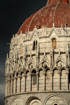 The Baptistry of St.John is a religious building in the Piazza dei Miracoli, a wide walled area in the centre of Pisa.The Duomo di Pisa is a cathedral built in Byzantine architectural style in marble and stone which stands in the Piazza dei Miracoli.