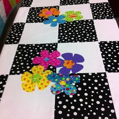 This was a quilt I made for my new great-niece!!  She loved the black & white background and the bright flowers :)