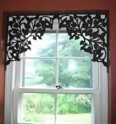 What a great idea for small bathroom window! Using shelf brackets as window treatments.