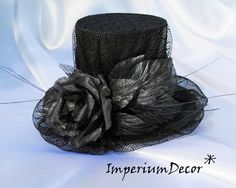 this hat is amazing? I could see a veil on it to put over the face in a wedding..or the brides maids!