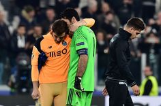 Porto's Spanish goalkeeper Iker Casillas (L) is comforted by Juventus' goalkeeper from Italy Gianluigi Buffon at the end of the UEFA Champions League football match Juventus vs FC Porto on March 14, 2017 at the Juventus stadium in Turin. Juventus won 1-0. Iker Casillas set a new record when featuring for Porto in their Champions League last 16, second leg against Juventus on Tuesday as he made his 175th appearance in European competition.  / AFP PHOTO / GIUSEPPE CACACE