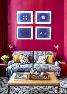 Deep, rich color — starting with C2 Paint's Mulberry on the walls — creates a warm, welcoming study in a Greenwich Village apartment. The clients' own sofa was reupholstered in Claudia by John Stefanidis, and their ottoman was recovered in Cebu by Dedar. Click through for more of the best home library design ideas.