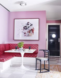 Designer Crush: Alexandra Loew // red upholstered dining bench, persian area rug, white lacquer dining table, pink wall