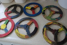 R: Make these steering wheels. Roxaboxen