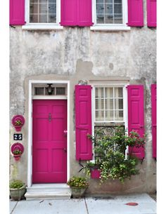 adore the pink shutters against the gray