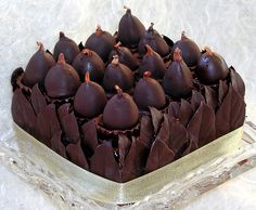 """""""chocolate walnut & fig torte,"""" by distopiandreamgirl, via Flickr -- From the photographer: """"chocolate walnut torte brushed with nocino (italian walnut liqueur); filled with fig preserves and nocino ganache; surrounded with belgian chocolate leaves; crowned with figs drenched in nocino, stuffed with ganache, & dipped in chocolate; nestled in chocolate cups"""" -- Sounds delicious!! Inspiration only, alas."""