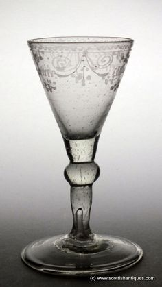 "Rococo engraved wine glass c1775 Origin : Dutch Colour : Clear Bowl : Conical Bowl Features : Rococo engraving around the rim Stem : Shoulder knop Foot : Conical, folded Pontil : Snapped Glass Type : Soda Size : 5⅛"" tall with a 2⅜"" bowl and 2⅞"" foot http://scottishantiques.com/georgian-wine-glasses/18th-century-continental-glass?product_id=6008#.V7Lol1srJeg"