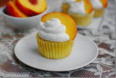 Peaches 'n' Cream Cupcakes are light yet dense and packed with sweet, summer peaches. | iowagirleats.com