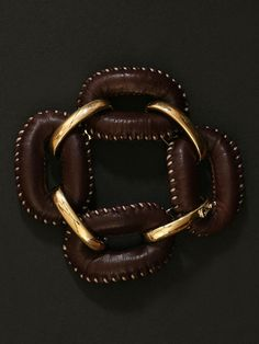 london collection. gold and leather bracelet.