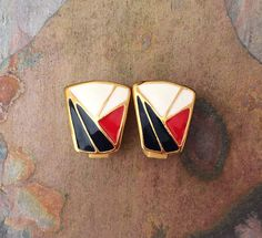 Vintage 80s enamel clip on earrings with navy red and white