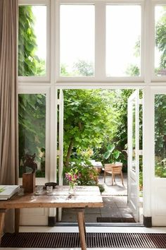 Wall of windows | white window panes + rustic wooden table