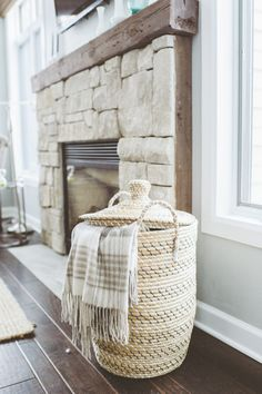 loving the idea of having a basket/hamper to store extra blankets in the living room.