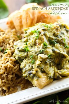 Creamy Spinach Artichoke Chicken... The Creamy spinach artichoke sauce over this chicken is beyond delicious! This is one dinner you will want to make over and over again! It is SO good!