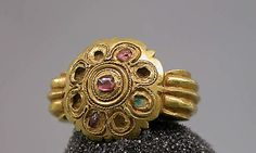 Stirrup-Shaped Ring with Stones Set in Circular Bezel, Eastern Javanese period, circa 975-1475, gold with stones, Java