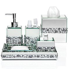 Each piece is a surround of sparkly beveled mirror, accented with a band of assorted Clear and Smoky crystals. Ricci Vanity Collection, $119.95
