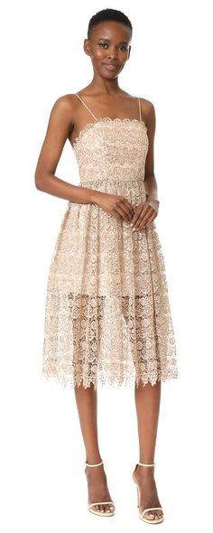 alma party dress by Alice + Olivia. A pretty alice + olivia party dress in shimmering, sequined metallic lace. Tiny pleats accent the waist. Spaghetti st...