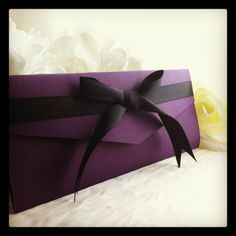 Purple  and Black Ribbon Invitation Pocketfold Suite with Silver and Purple Glitter. $5.00, via Etsy.