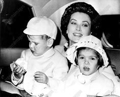 Princess Grace Monaco held Prince Albert, 3, and Princess Caroline, 4, on arrival by plane from Nice, to visit relatives in Philadelphia. Prince Rainer will follow. It is the children's first visit..