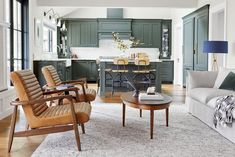 Emily Henderson has a lot of design tricks up her sleeve. Find out how she made this 270 square foot living room look spacious Portland House, Portland Oregon, Indoor Outdoor Fireplaces, Kitchen Family Rooms, House Rooms, Living Rooms, Kitchen Remodel, Outdoor Furniture Sets, Outdoor Rooms