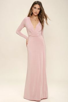 Usher in the seasons with style in the Chic-quinox Blush Pink Long Sleeve Maxi Dress! Blush Pink jersey knit shapes a surplice bodice framed by long sleeves. Billowing maxi skirt falls below a gathered waistline for a stunning finish.