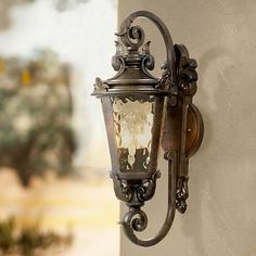 Inspired by the romantic Mediterranean, this handsome outdoor wall light adds curb appeal to porches and entryways.