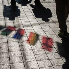 Chris Steele-Perkins. JAPAN. Tokyo. 2015. Around Nakano. Light through plastic flags.
