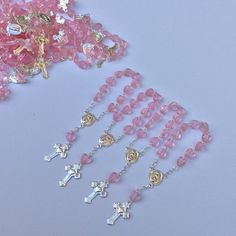 Mini rosaries perfect for baptism favors, approximately 4 long Available in pink/silver, white/gold and white/silver blue/gold blue /silver pink /gold Price is for 24 pieces. Only the rosaries does not include the bags. You can use them as a baptism favors, first communion. We