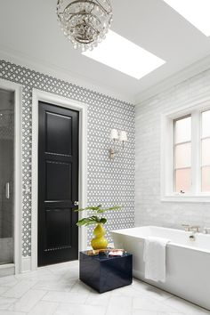To break up the monotony of the mostly marble master bath, different sized tiles and patterns for the floor and tub surround were used. - Photo: Werner Straube / Design: Christine Hughes