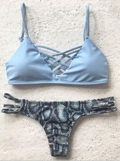 Pastel Blue Lattice Triangle Bikini Bathing Suits features criss cross lattice at front design,and structured bust cups. Fully lined. Perfect with patternedn Bottoms, or mixed up with anything you're feeling.