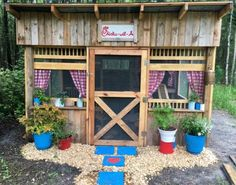 Colorful planters and pavers, plus windows lined with cute gingham curtains, make this coop a feast for the eyes.