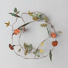 Metallic Leaves Garland: Metal leaves in an assortment of shapes and polished hues adorn this delicate strand for sprucing up natural décor. - Metal, wire - Wipe clean with damp cloth - Indoor or sheltered outdoor use - Imported Fall Door Decorations, Flower Decorations, Fall Decor, Deco Floral, Arte Floral, Leaf Garland, Floral Garland, Wreath Hanger, Nature Decor