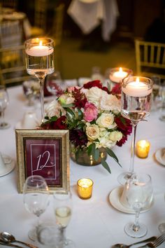 Plenty of candles surrounded the centerpieces at this rustic chic wedding in the mountains. Get more real wedding inspiration and wedding planning tips on our website now! Tall Wedding Centerpieces, Wedding Flower Arrangements, Wedding Table Centerpieces, Floral Centerpieces, Wedding Favors, Wedding Decorations, Centerpiece Ideas, Chic Wedding, Floral Wedding