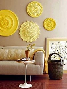 ceiling medallions as wall art in yellow. Great collection display