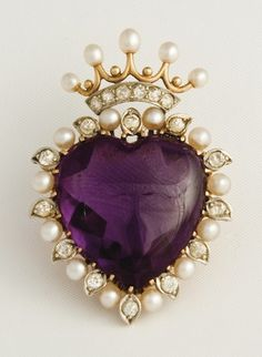 A gold, amethyst, seed pearl and diamond brooch in the form of crowned love heart.