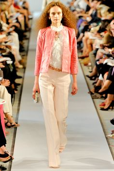 Oscar de la Renta Spring 2012: I love how classy this ensemble is! The salamander pink jacket is perfect for spring. The ruffled lace blouse is classy. The off white wide leg trousers are sophisticated. The puffy hair add some edge!