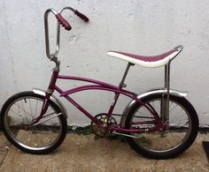 "Vintage Western Flyer Buzz Bike Muscle Bike in ""Go Fast"" Grape. this was the model of bike I had as a kid, except it had a rad sissy bar and I took the front fender off so when you would drive through the mud it would splatter your pants legs. Vintage Bicycles, Vintage Motorcycles, Cool Bicycles, Cool Bikes, Banana Seat Bike, Lowrider Bicycle, Old School Toys, Chopper Bike, Bike Wheel"
